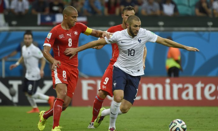 France's forward Karim Benzema (front R) vies for the ball with Switzerland's midfielder Gokhan Inler (L) Switzerland's forward Haris Seferovic (behind Benzema) during a Group E football match between Switzerland and France at the Fonte Nova Arena in Salvador during the 2014 FIFA World Cup on June 20, 2014. (ODD ANDERSEN/AFP/Getty Images)