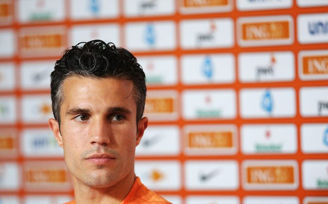 Robin van Persie speaks to the media during the Netherlands Press Conference at the 2014 FIFA World Cup Brazil held at the Estadio Jose Bastos Padilha Gavea on June 20, 2014 in Rio de Janeiro, Brazil. (Photo by Dean Mouhtaropoulos/Getty Images)