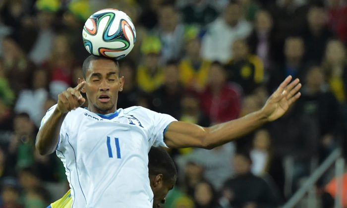 Honduras' forward Jerry Bengtson heads the ball during a Group E football match between Honduras and Ecuador at the Baixada Arena in Curitiba during the 2014 FIFA World Cup on June 20, 2014. (GABRIEL BOUYS/AFP/Getty Images)