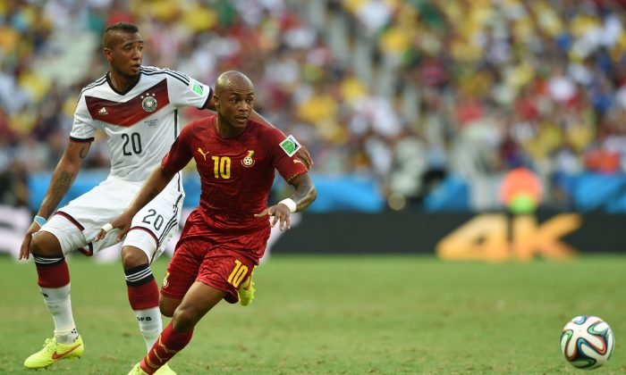 Ghana's midfielder Andre Ayew (R) vies with Germany's defender Jerome Boateng during a Group G football match between Germany and Ghana at the Castelao Stadium in Fortaleza during the 2014 FIFA World Cup on June 21, 2014 (CARL DE SOUZA/AFP/Getty Images)