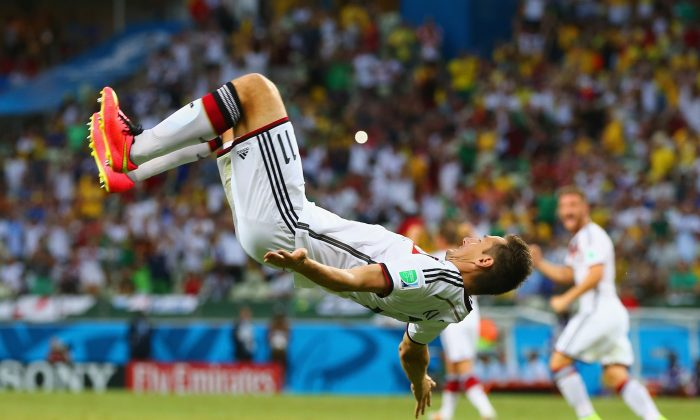 Miroslav Klose of Germany does a flip in celebration of scoring his team's second goal during the 2014 FIFA World Cup Brazil Group G match between Germany and Ghana at Castelao on June 21, 2014 in Fortaleza, Brazil. (Photo by Martin Rose/Getty Images)