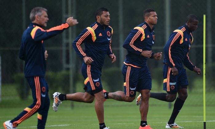 (From L to R) Colombia's defender Carlos Valdes, Colombia's midfielder Fredy Guarin and Colombia's forward Adrian Ramos take part in a training session at the President Laudo Natel Athlete Formation Center in Cotia, Sao Paulo, on June 21, 2014 during the 2014 FIFA World Cup. (EITAN ABRAMOVICH/AFP/Getty Images)