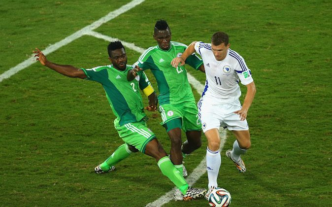 Joseph Yobo and Kenneth Omeruo of Nigeria compete for the ball with Edin Dzeko of Bosnia and Herzegovina during the 2014 FIFA World Cup Group F match between Nigeria and Bosnia-Herzegovina at Arena Pantanal on June 21, 2014 in Cuiaba, Brazil. (Photo by Clive Brunskill/Getty Images)