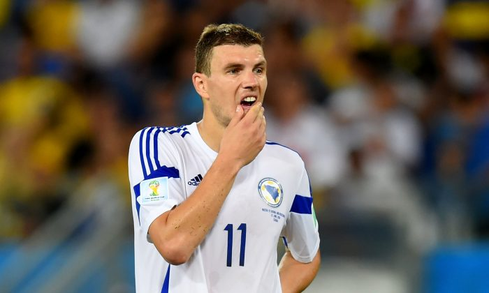Edin Dzeko of Bosnia and Herzegovina looks dejected after a 1-0 defeat in the 2014 FIFA World Cup Group F match between Nigeria and Bosnia-Herzegovina at Arena Pantanal on June 21, 2014 in Cuiaba, Brazil. (Photo by Stu Forster/Getty Images)