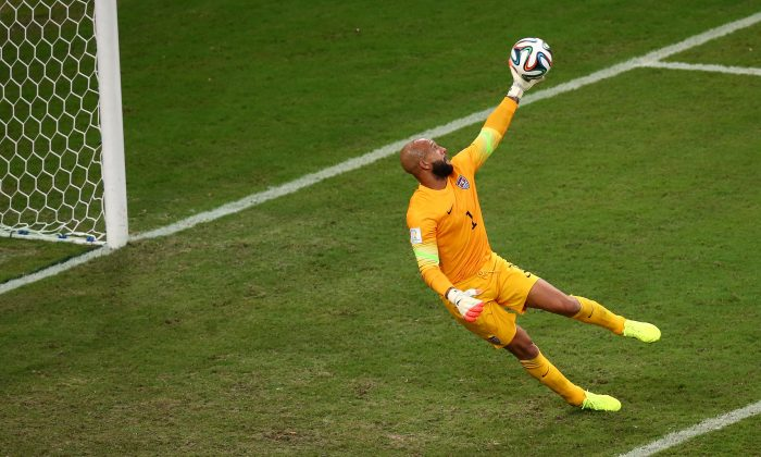 Tim Howard of the United States makes a save during the 2014 FIFA World Cup Brazil Group G match between the United States and Portugal at Arena Amazonia on June 22, 2014 in Manaus, Brazil. (Photo by Elsa/Getty Images)