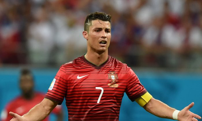 Portugal's forward Cristiano Ronaldo gestures during a Group G match between USA and Portugal at the Amazonia Arena in Manaus during the 2014 FIFA World Cup on June 22, 2014. (FRANCISCO LEONG/AFP/Getty Images)