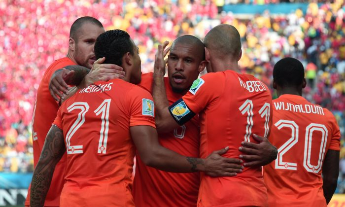 Netherlands' forward Memphis Depay (C) celebrates scoring with his teammates during the Group B football match between Netherlands and Chile at the Corinthians Arena in Sao Paulo during the 2014 FIFA World Cup on June 23, 2014. (DAMIEN MEYER/AFP/Getty Images)