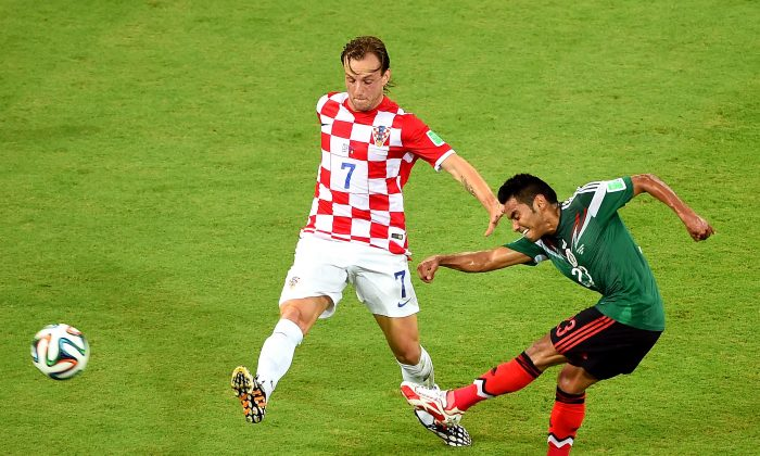 Ivan Rakitic of Croatia and Jose Juan Vazquez of Mexico compete for the ball during the 2014 FIFA World Cup Brazil Group A match between Croatia and Mexico at Arena Pernambuco on June 23, 2014 in Recife, Brazil. (Photo by Laurence Griffiths/Getty Images)