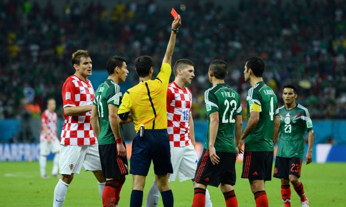 Ante Rebic of Croatia receives a red card during the 2014 FIFA World Cup Brazil Group A match between Croatia and Mexico at Arena Pernambuco on June 23, 2014 in Recife, Brazil. (Photo by Jamie McDonald/Getty Images)
