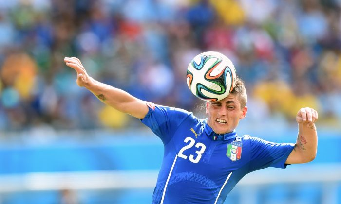 Italy's midfielder Marco Verratti heads the ball during a Group D football match between Italy and Uruguay at the Dunas Arena in Natal during the 2014 FIFA World Cup on June 24, 2014. (JAVIER SORIANO/AFP/Getty Images)