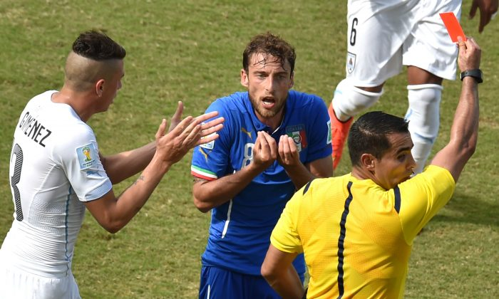 Italy's midfielder Claudio Marchisio(C) reacts as he is shown a red card by Mexican referee Marco Antonio Rodriguez Moreno during a Group D football match between Italy and Uruguay at the Dunas Arena in Natal during the 2014 FIFA World Cup on June 24, 2014. (YASUYOSHI CHIBA/AFP/Getty Images)