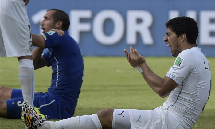 Uruguay's forward Luis Suarez reacts during a Group D football match between Italy and Uruguay at the Dunas Arena in Natal during the 2014 FIFA World Cup on June 24, 2014. Uruguay won 1-0. (DANIEL GARCIA/AFP/Getty Images)