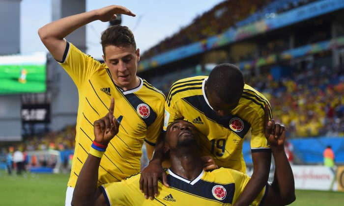 Jackson Martinez of Colombia (center) celebrates scoring his team's third goal during the 2014 FIFA World Cup Brazil Group C match between Japan and Colombia at Arena Pantanal on June 24, 2014 in Cuiaba, Brazil. (Christopher Lee/Getty Images)