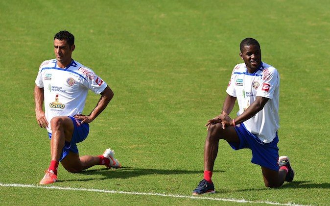 Costa Rica's defender Johnny Acosta (L) and Costa Rica's forward Joel Campbell stretch during a training session at the Vila Belmiro Stadium, in Santos on June 25, 2014 as part of the FIFA 2014 World Cup in Brazil. (RONALDO SCHEMIDT/AFP/Getty Images)