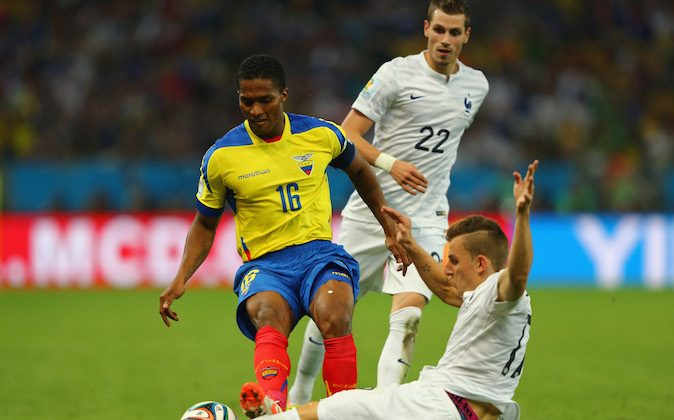Antonio Valencia of Ecuador challenges Lucas Digne of France during the 2014 FIFA World Cup Brazil Group E match between Ecuador and France at Maracana on June 25, 2014 in Rio de Janeiro, Brazil. Valencia was sent off with a red card for the foul. (Photo by Jamie Squire/Getty Images)