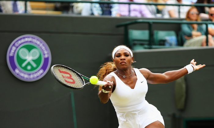 Serena Williams of the United States in action during her Ladies' Singles second round match against Chanelle Scheepers of South Africa on day four of the Wimbledon Lawn Tennis Championships at the All England Lawn Tennis and Croquet Club at Wimbledon on June 26, 2014 in London, England. (Photo by Al Bello/Getty Images)