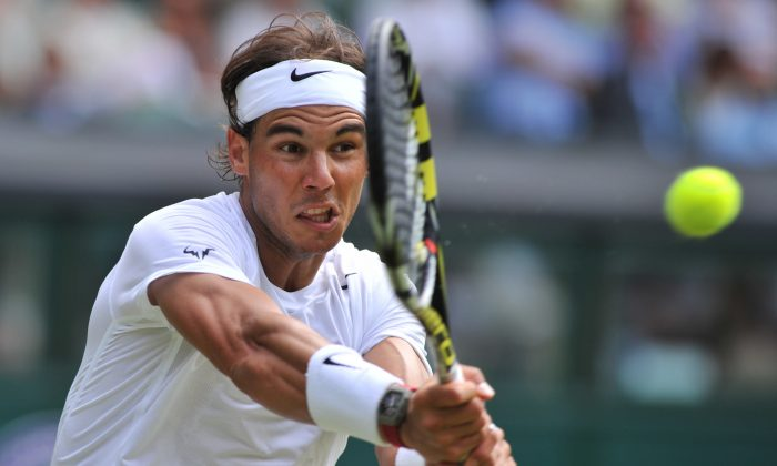 Spain's Rafael Nadal returns against Czech Republic's Lukas Rosol during their men's singles second round match on day four of the 2014 Wimbledon Championships at The All England Tennis Club in Wimbledon, southwest London, on June 26, 2014. Nadal won 4-6, 7-6, 6-4, 6-4. (GLYN KIRK/AFP/Getty Images)