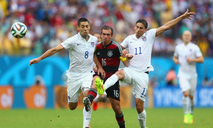 Philipp Lahm of Germany is challenged by Clint Dempsey (L) and Alejandro Bedoya of the United States during the 2014 FIFA World Cup Brazil group G match between the United States and Germany at Arena Pernambuco on June 26, 2014 in Recife, Brazil. (Michael Steele/Getty Images)