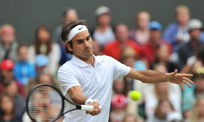 Switzerland's Roger Federer returns against Luxembourg's Gilles Muller during their men's singles second round match on day four of the 2014 Wimbledon Championships at The All England Tennis Club in Wimbledon, southwest London, on June 26, 2014. Federer won 6-3, 7-5, 6-3. (GLYN KIRK/AFP/Getty Images)