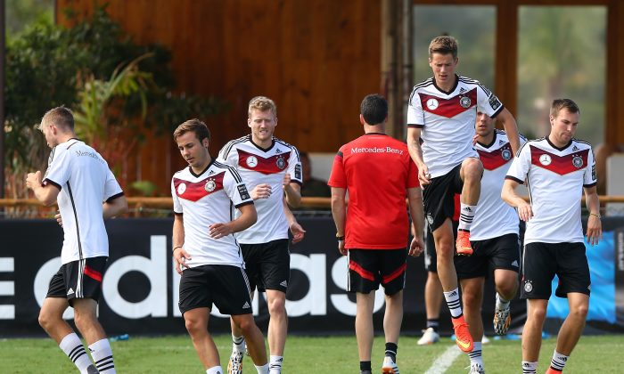 Erik Durm of Germany (R) jumps during the German national team training at Campo Bahia on June 27, 2014 in Santo Andre, Brazil. (Martin Rose/Getty Images)