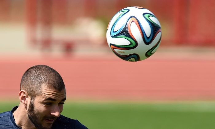 France's forward Karim Benzema heads the ball during a training session in Brasilia on June 29, 2014, on the eve of their FIFA 2014 World Cup Round of 16 football match against Nigeria. (JEWEL SAMAD/AFP/Getty Images)