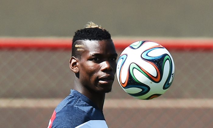 France's midfielder Paul Pogba eyes the ball during a training session in Brasilia on June 29, 2014, on the eve of their FIFA 2014 World Cup Round of 16 football match against Nigeria. (JEWEL SAMAD/AFP/Getty Images)