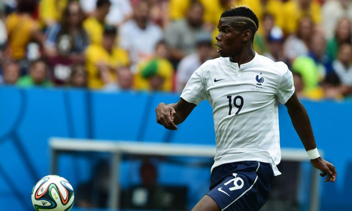 France's midfielder Paul Pogba in action during a Round of 16 football match between France and Nigeria at Mane Garrincha National Stadium in Brasilia during the 2014 FIFA World Cup on June 30, 2014. (FRANCOIS XAVIER MARIT/AFP/Getty Images)