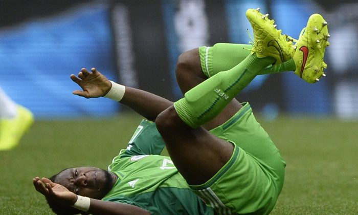 Nigeria's midfielder Ogenyi Onazi reacts after being fouled during the round of 16 football match between France and Nigeria at the Mane Garrincha National Stadium in Brasilia during the 2014 FIFA World Cup on June 30, 2014. (FRANCK FIFE/AFP/Getty Images)