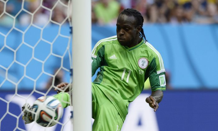 Nigeria's forward Victor Moses kicks the ball away from the goal during the round of 16 football match between France and Nigeria at the Mane Garrincha National Stadium in Brasilia during the 2014 FIFA World Cup on June 30, 2014. (FRANCK FIFE/AFP/Getty Images)