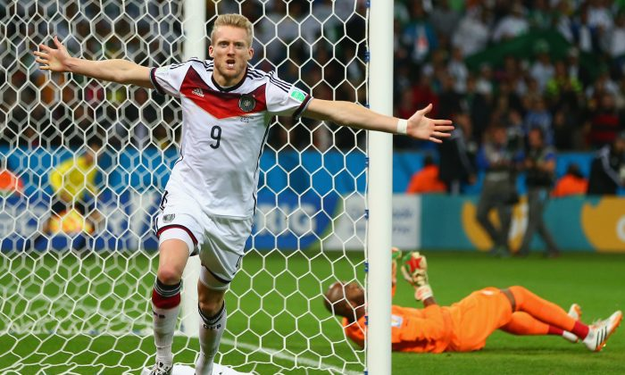 Andre Schuerrle of Germany celebrates scoring his team's first goal past goalkeeper Rais M'Bolhi of Algeria during the 2014 FIFA World Cup Brazil Round of 16 match between Germany and Algeria at Estadio Beira-Rio on June 30, 2014 in Porto Alegre, Brazil. (Photo by Jamie Squire/Getty Images)