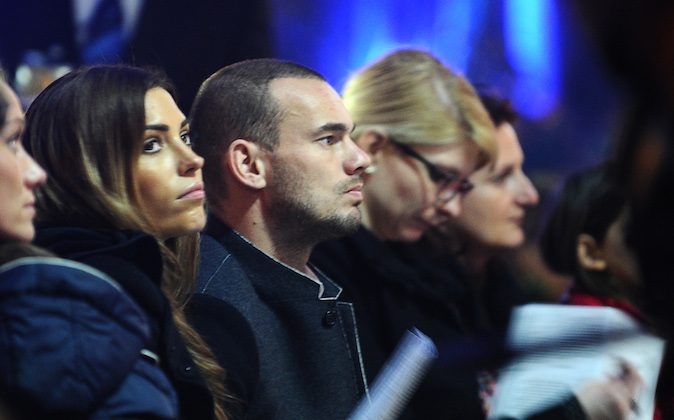 Galatasaray's Dutch midfielder Wesley Sneijder (C) and his wife Spanish-Dutch actress and TV host Yolanthe Sneijder-Cabau (L) attend mass in Saint Anthony of Padua Church in Istanbul on Christmas Eve, December 24, 2013. (OZAN KOSE/AFP/Getty Images)