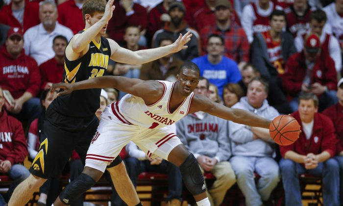 Noah Vonleh #1 of the Indiana Hoosiers stretches to pull in the ball as Adam Woodbury #34 of the Iowa Hawkeyes guards at Assembly Hall on February 27, 2014 in Bloomington, Indiana. Indiana defeated Iowa 93-86. (Michael Hickey/Getty Images)
