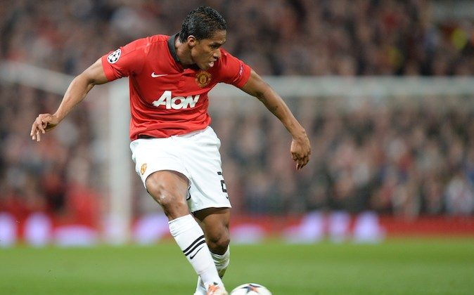 Manchester United's Ecuadorian midfielder Antonio Valencia controls the ball during the UEFA Champions League quarter-final first leg football match between Manchester United and Bayern Munich at Old Trafford in Manchester on April 1, 2014. The match ended in a 1-1 draw. (CHRISTOF STACHE/AFP/Getty Images)
