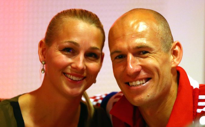 Arjen Robben of Bayern Muenchen celebrates with his wife Bernadien during the FC Bayern Muenchen Champions party after winning the German DFB Cup finale at Deutsche Telekom represantive house on May 17, 2014 in Berlin, Germany. (Alexander Hassenstein/Bongarts/Getty Images)