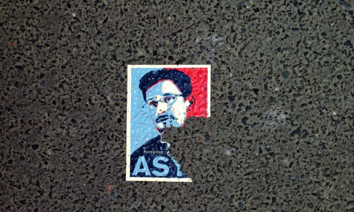 A sticker featuring fugitive U.S. intelligence leaker Edward Snowden is seen on the pavement in a Berlin street, on May 26, 2014. (Odd Andersen/AFP/Getty Images)