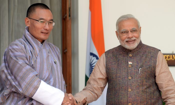 India's newly sworn-in Prime Minister Narendra Modi (R) shakes hands with Bhutan Prime Minister Tshering Tobgay during a meeting in New Delhi on May 27, 2014. Indian Prime Minister Narendra Modi met regional South Asian leaders for talks in New Delhi May 27 after he was was sworn in May 26 as prime minister. (Raveendran/AFP/Getty Images)