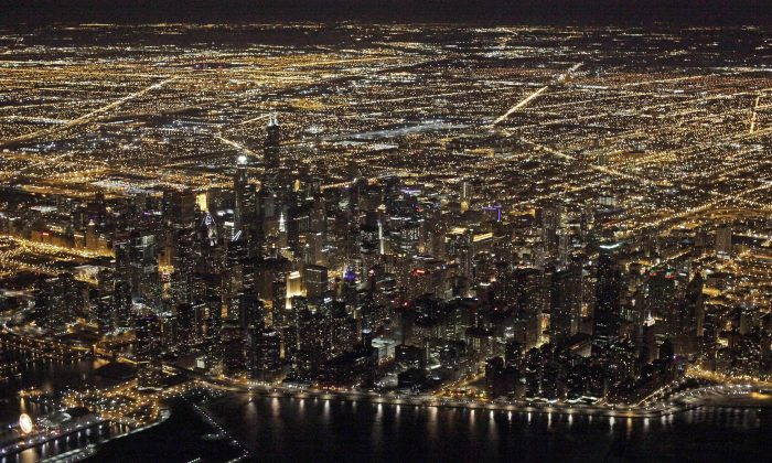 "FILE - This Sunday, Nov. 24, 2013, file photo, shows an aerial view at night of the downtown Chicago skyline. Star Wars"" creator George Lucas has selected Chicago to build his museum of art and movie memorabilia. (AP Photo/Kiichiro Sato, File)"