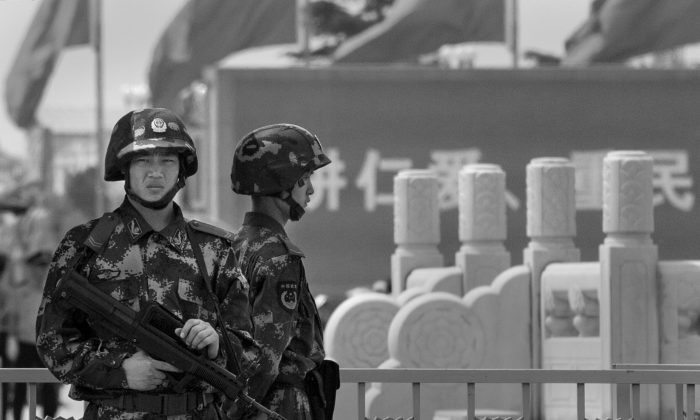 Chinese Paramilitary police stand guard in Tiananmen Square on June 4, 2014 in Beijing, China. (Kevin Frayer/Getty Images)