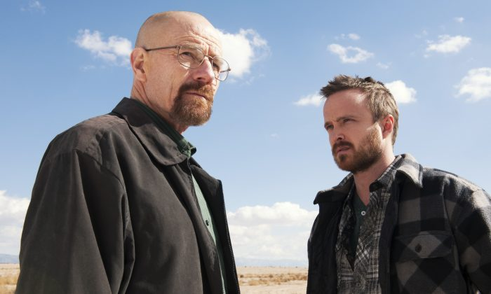 """Breaking Bad will not return for another season. Rumors about a """"Season 6"""" are fake and were published by satirical news websites. Bryan Cranston as Walter White, left, and Aaron Paul as Jesse Pinkman in a scene from """"Breaking Bad."""" (AP Photo/AMC, Frank Ockenfels )"""