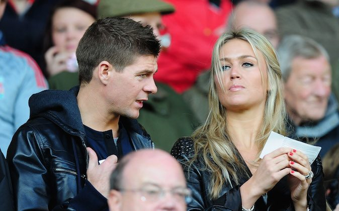 Steven Gerrard and his wife Alex Curran take their seats prior to the Barclays Premier League match between Liverpool and Manchester United at Anfield on October 25, 2009 in Liverpool, England. (Clive Mason/Getty Images)