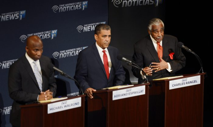 Rep. Charles Rangel, D-NY, right, addresses the panel as Minister Michael Waldrond, Jr., left and New York State Sen. Adriano Espaillat, D-NY, listen, during their televised debate from Lehman College in New York, Wednesday, June 11, 2014. They are seeking the Democratic Party's nomination to run for the seat New York 13th Congressional District. (AP Photo/New York Daily News, Peter Gabel)