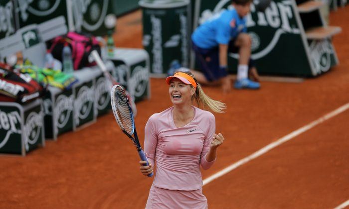 Russia's Maria Sharapova reacts as she defeats Australia's Samantha Stosur during their fourth round match of  the French Open tennis tournament at the Roland Garros stadium, in Paris, France, Sunday, June 1, 2014. (AP Photo/Michel Spingler)