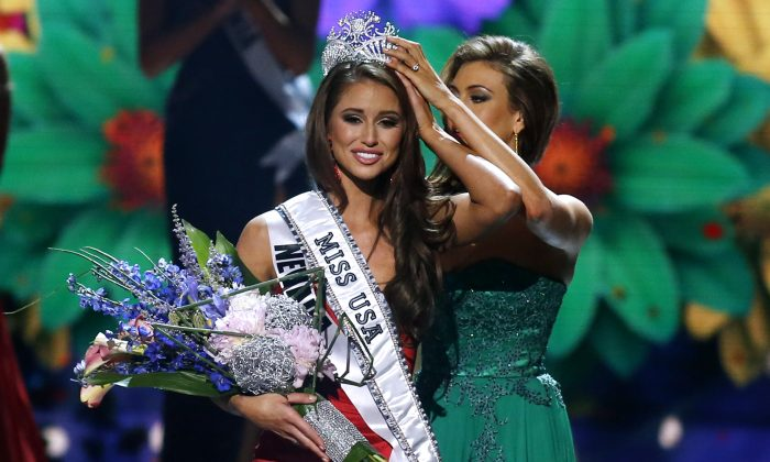 Miss Nevada USA Nia Sanchez is crowned Miss USA during the pageant in Baton Rouge, La., Sunday, June 8, 2014. (AP Photo/Jonathan Bachman)