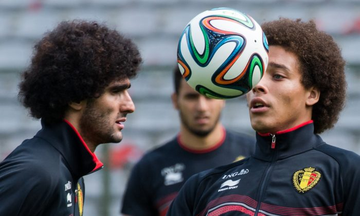 Belgium's national soccer team players Axel Witsel, right, and Marouane Fellaini practice during their last training in Belgium before leaving for Brazil at the King Baudouin stadium in Brussels, Sunday June 8, 2014. Fellaini scored in the first World Cup game on Tuesday. (AP Photo/Geert Vanden Wijngaert)
