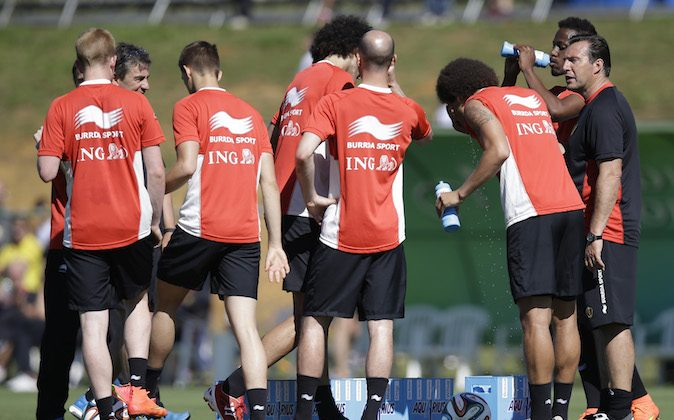 Belgium's head coach Marc Wilmots, right, talks with his players during a team training session in Mogi Das Cruzes, Brazil, Friday, June 13, 2014. Belgium play in group H of the 2014 soccer World Cup. (AP Photo/Andrew Medichini)