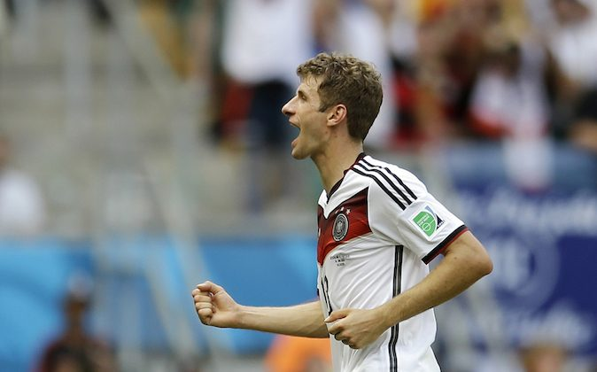 Germany's Thomas Mueller runs off the pitch during the second half after scoring his side's fourth goal during the group G World Cup soccer match between Germany and Portugal at the Arena Fonte Nova in Salvador, Brazil, Monday, June 16, 2014.  (AP Photo/Natacha Pisarenko)