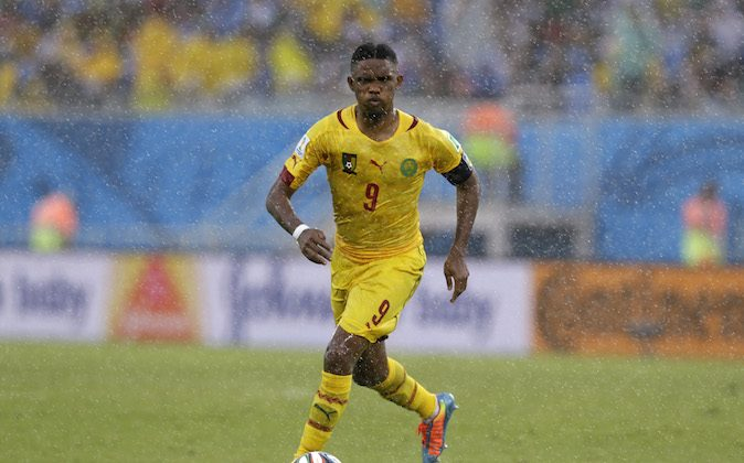 Cameroon's Samuel Eto'o runs with the ball during the group A World Cup soccer match between Mexico and Cameroon in the Arena das Dunas in Natal, Brazil, Friday, June 13, 2014.  (AP Photo/Ricardo Mazalan)