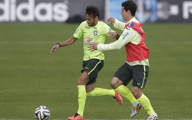 Brazil's Neymar, left, and Hernanes practice during a training session of Brazilian national soccer team, at the Granja Comary training center in Teresopolis, Brazil, Monday, June 9, 2014. Brazil play in group A of the 2014 soccer World Cup. (AP Photo/Andre Penner)