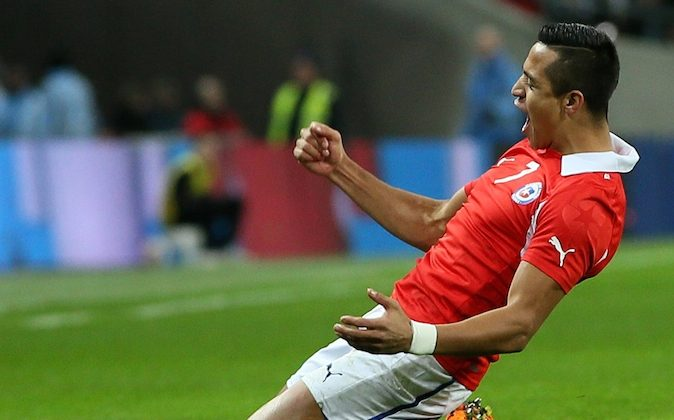 Chile's Alexis Sanchez celebrates after scoring a goal during the international friendly soccer match between England and Chile at Wembley Stadium in London. (AP Photo/Alastair Grant