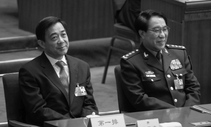 Xu Caihou, right, former deputy chairman of the CPC Central Military Commission, which controls China's military, and former Politburo member Bo Xilai attend the closing session of the National People's Congress at the Great Hall of the People in Beijing, China, March 14, 2012. (AP Photo/Vincent Thian, File)